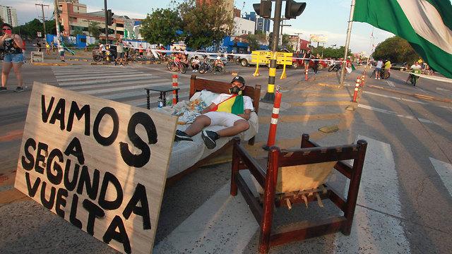 בחירות הפגנות בוליביה נגד הנשיא אבו מוראלס (צילום: AFP)