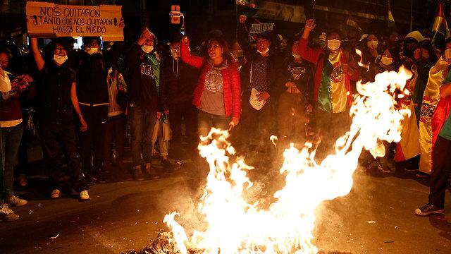 בחירות הפגנות בוליביה נגד הנשיא אבו מוראלס (צילום: AP)