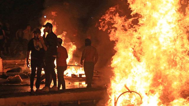 עיראק הפגנות כרבלא (צילום: AFP)