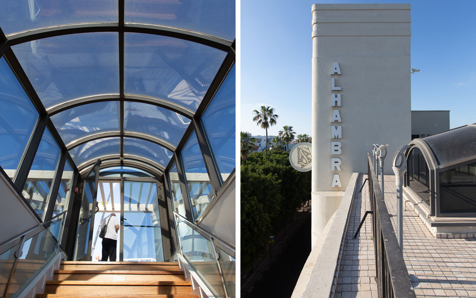 האותיות הוותיקות של ''אלהמברה'' ולצדן סמל הסיינטולוגיה, בחזית הבניין. משמאל: גרם המדרגות שמעפיל לגג (צילום: דור נבו)