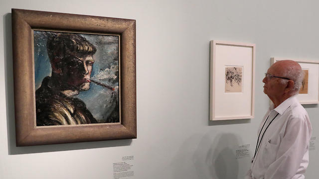 Visitors at the 'Fateful Choices Art from the Gurlitt Trove exhibition' at the Israel Museum in Jerusalem