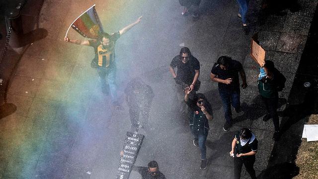 הפגנות מחאה סנטיאגו צ'ילה (צילום: AFP)