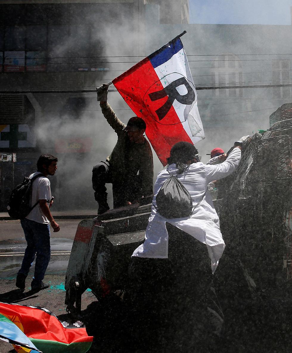 הפגנות מחאה סנטיאגו צ'ילה (צילום: רויטרס)