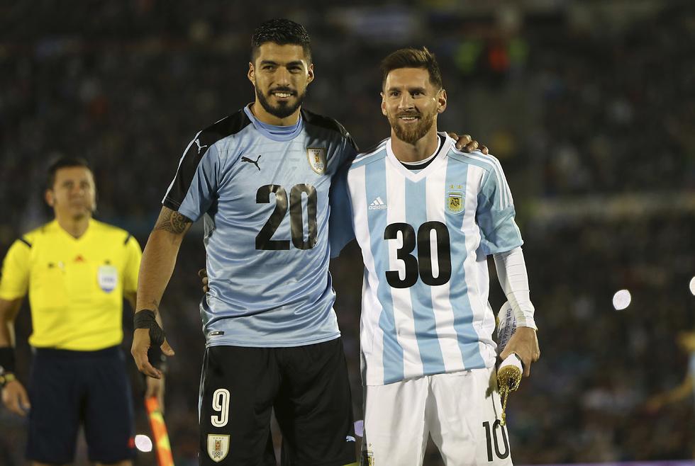 לאו מסי ולואיס סוארס (צילום: AP)