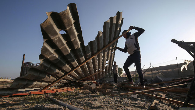 Gazans inspect the damage caused by Israeli strikes overnight (Photo: AFP)