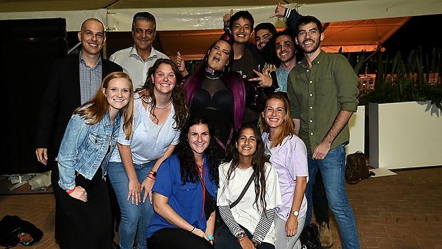 Masa staff and participants alongside singer Netta Barzilai (center) (Photo: Ran Biran)