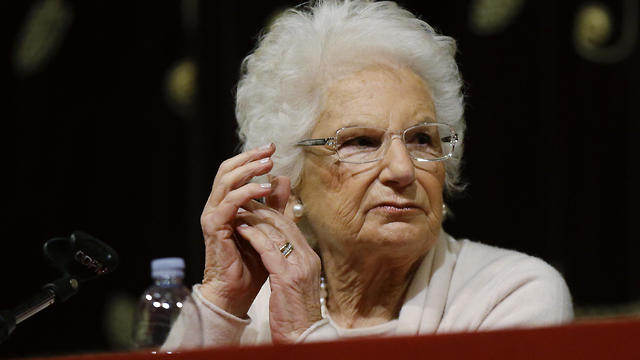 Holocaust survivor Liliana Segre speaks with young students on the occasion of an Holocaust remembrance, at the Arcimboldi theatre in Milan, Italy (Photo: AP)