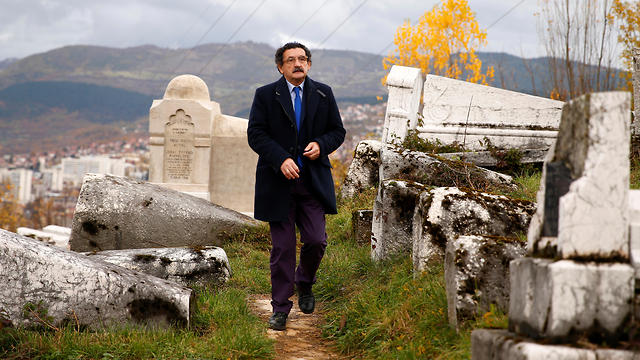 Eli Tauber stands near the resting place of a Jewish historian, whose real name was Mose Attias, known as Zeki Effendi Rafaelovic, at the Jewish cemetery in Sarajevo, Bosnia and Herzegovina, Nov. 6, 2019