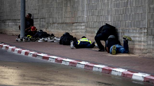 Israelis take cover from Gaza rocket fire in Sderot (Photo: AP)