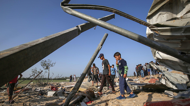 Palestinians inspect damage following an IAF airstrike in Gaza (Photo: AFP)