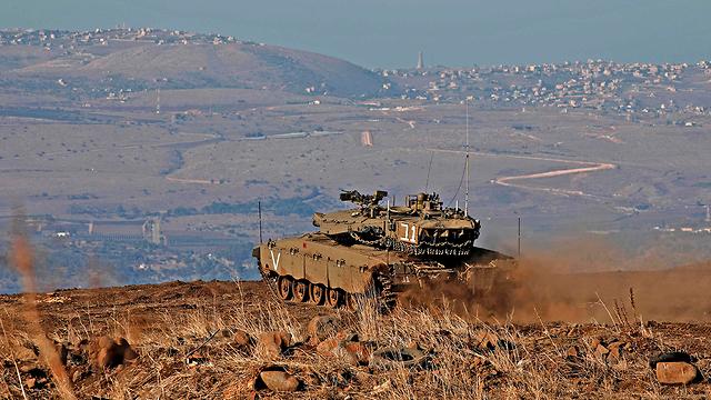 An Israeli tank on the Syrian border (Photo: AFP)