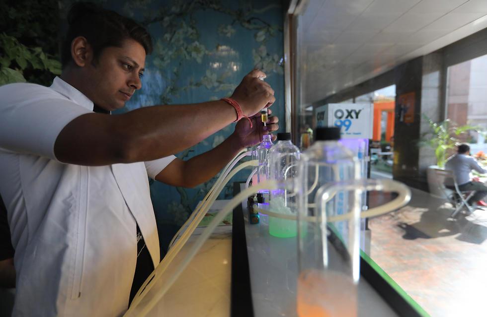 זיהום אוויר ניו דלהי הודו פאב ה חמצן ה טהור (צילום: EPA)