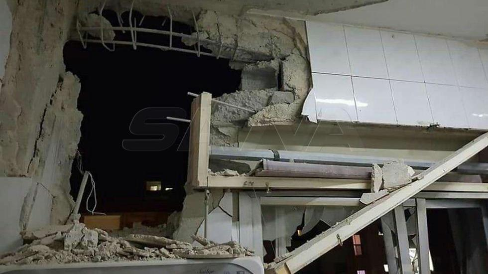 Damascus building damaged in Israeli air strike