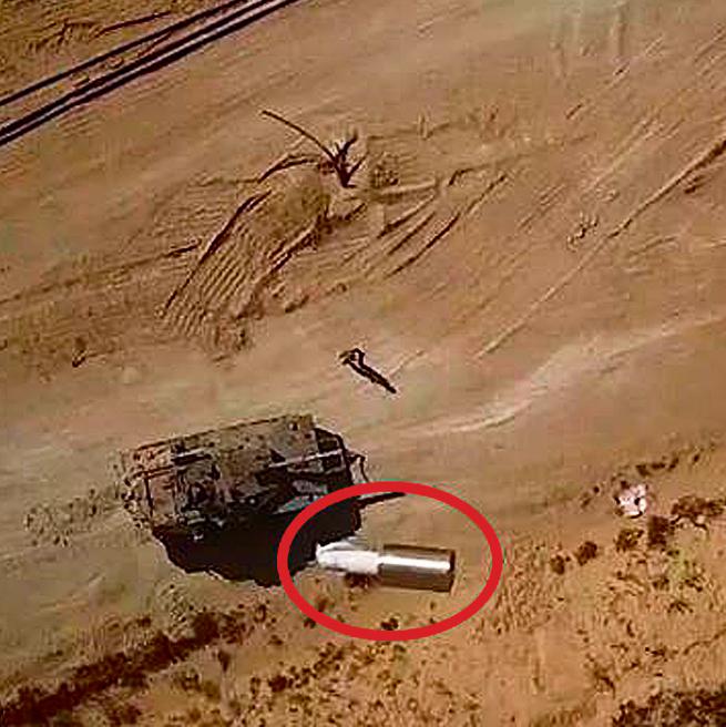 צילום מתוך סרטון הג'יהאד האיסלאמי, המתעד הטלת מטען מרחפן מעל לטנק ישראלי, ולידו חייל