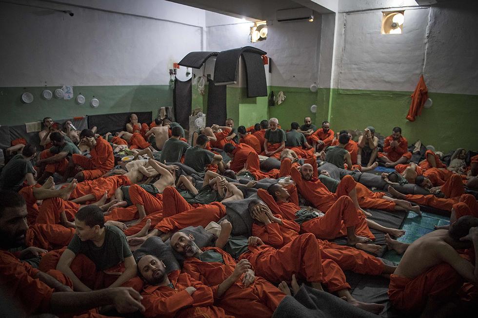 תמונות השנה AFP כלא כורדי לוחמי דאעש סוריה (צילום: AFP)