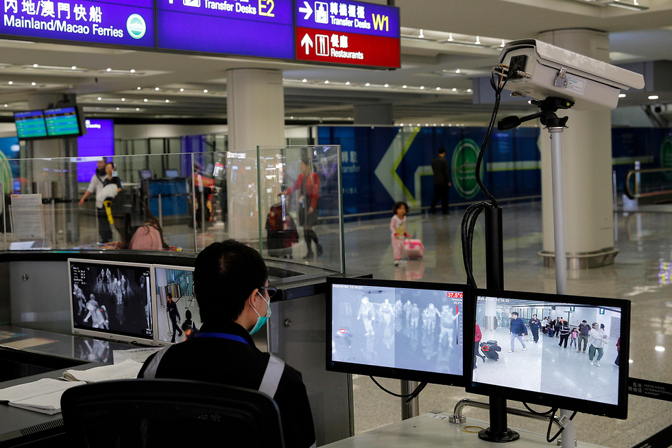 הונג קונג נמל תעופה בדיקות ל באים מ ווהאן סין נגיף מסתורי (צילום: AP)