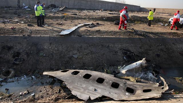 זירת התרסקות המטוס האוקראיני (צילום: EPA)
