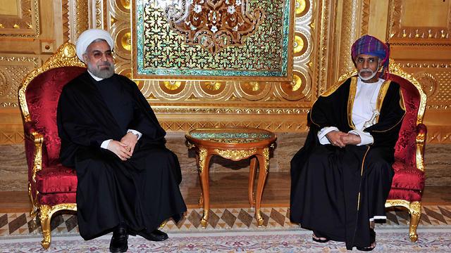 סולטן עומאן קאבוס בן סעיד עם נשיא איראן חסן רוחאני 2014 (צילום: AFP)