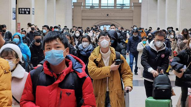 סין תחנת רכבת ב ווהאן העיר שבה התפרץ נגיף ה קורונה (צילום: gettyimages)