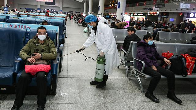 סין נגיף תחנת רכבת ב ננצ'אנג קורונה (צילום: EPA)