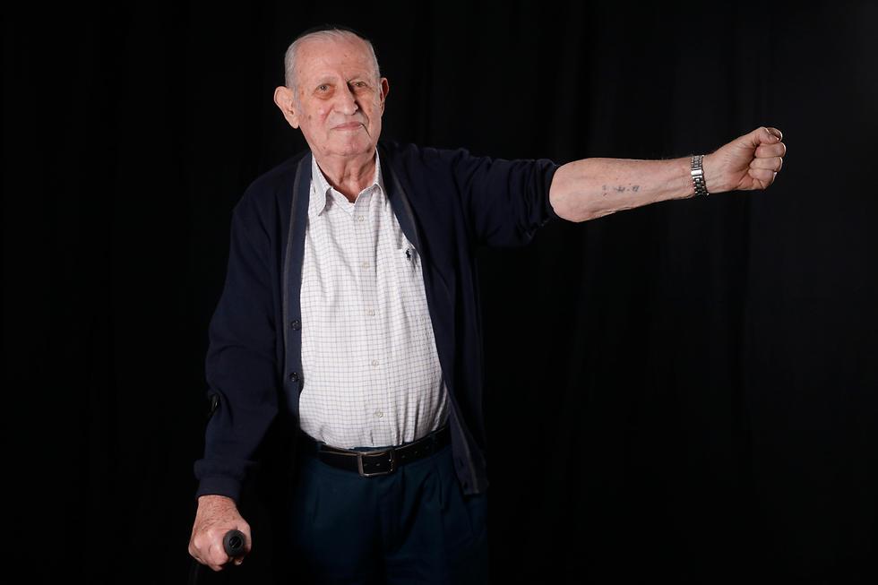ניצול שואה אברהם גרשום בינט אושוויץ (צילום: AFP)