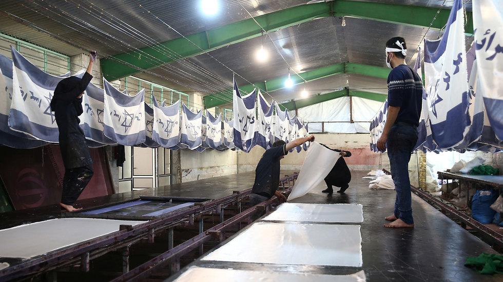 איראן מפעל לייצור דגלים של ישראל ו ארה