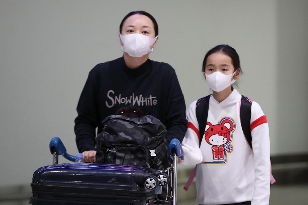 נוסעים טיסה שדה תעופה אוסטרליה נגיף וירוס קורונה ווהאן סין (צילום: gettyimages)