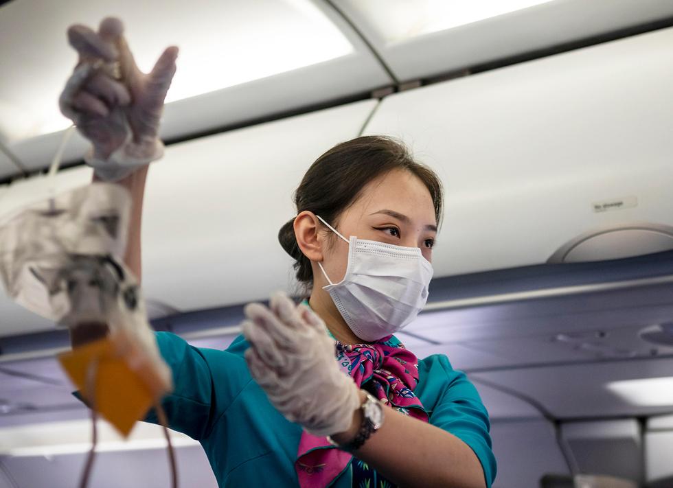 Стюардесса авиакомпании Камбоджи. Фото: EPA