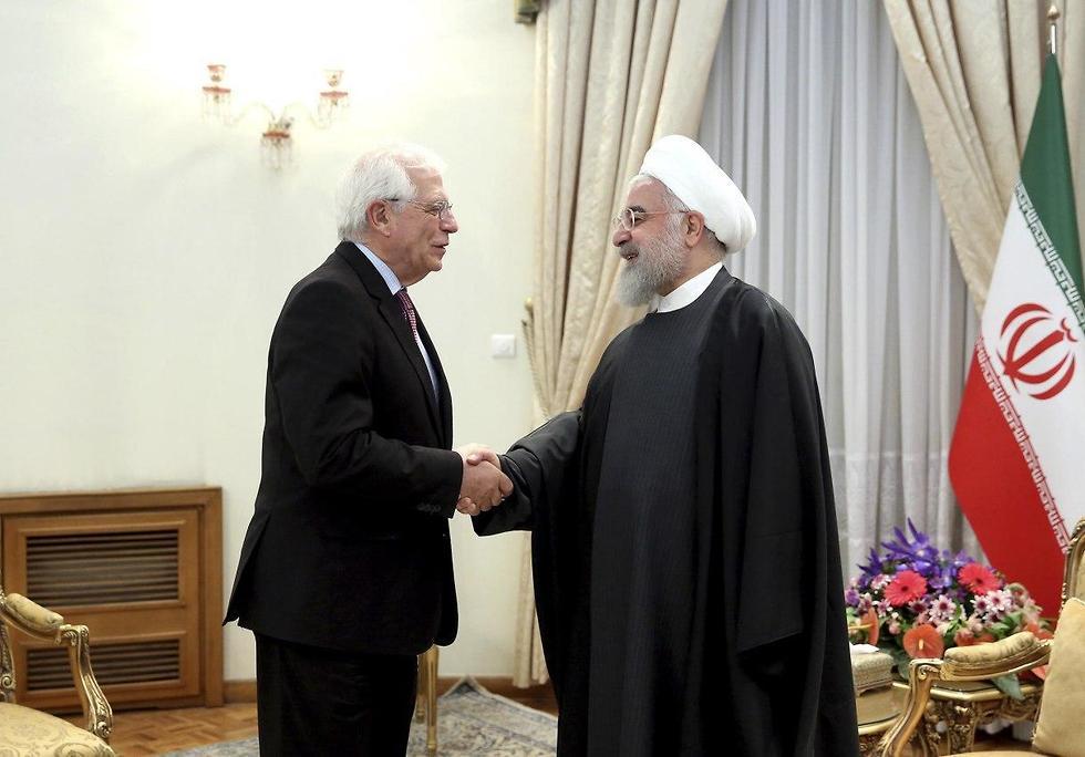 שר החוץ של האיחוד האירופי ג'וזל בורל עם נשיא איראן חסן רוחאני (צילום: AP)