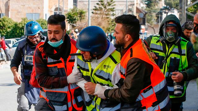 צלם רויטרס אשר נפצע (צילום: AFP)