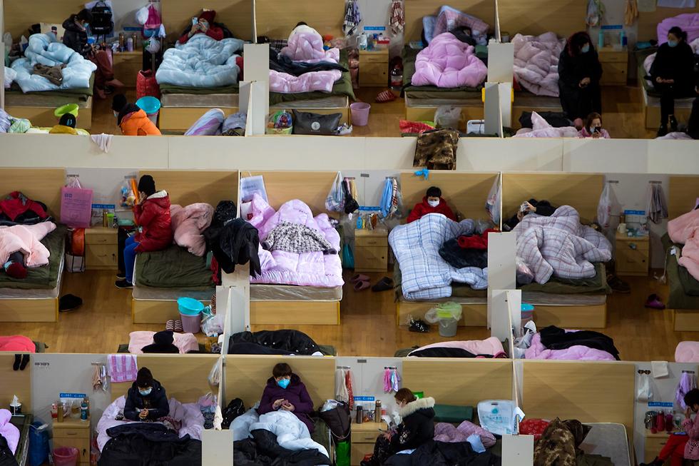 מרכז ספורט הפך ל בית חולים נגד נגיף הקורונה וירוס קורונה ווהאן סין (צילום: AP)