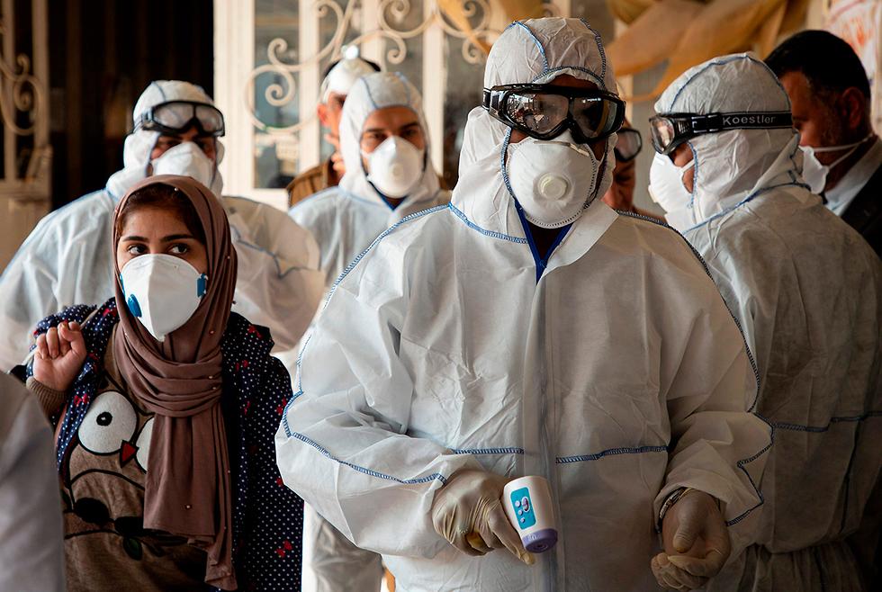 Проверка в Ираке для вернувшихся из Ирана. Фото: AFP (צילום: AFP)