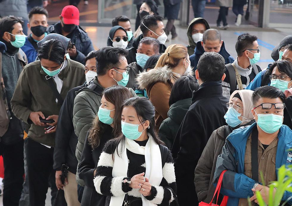 Южнокорейцы в Сеуле. Фото: EPA