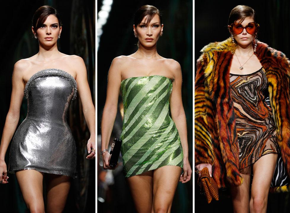 ליידיז, הכינו עצמכן: המיקרו-מיני חוזר, והפעם קצר יותר, צמוד יותר ונוצץ יותר, כפי שאפשר ללמוד מתמונת הסיום של בית האופנה ורסאצ'ה, עם הדוגמניות קאיה גרבר, בלה חדיד וקנדל ג'נר, חנוטות בשמלות מיני חושפות רגליים גבעוליות (צילום: AP)