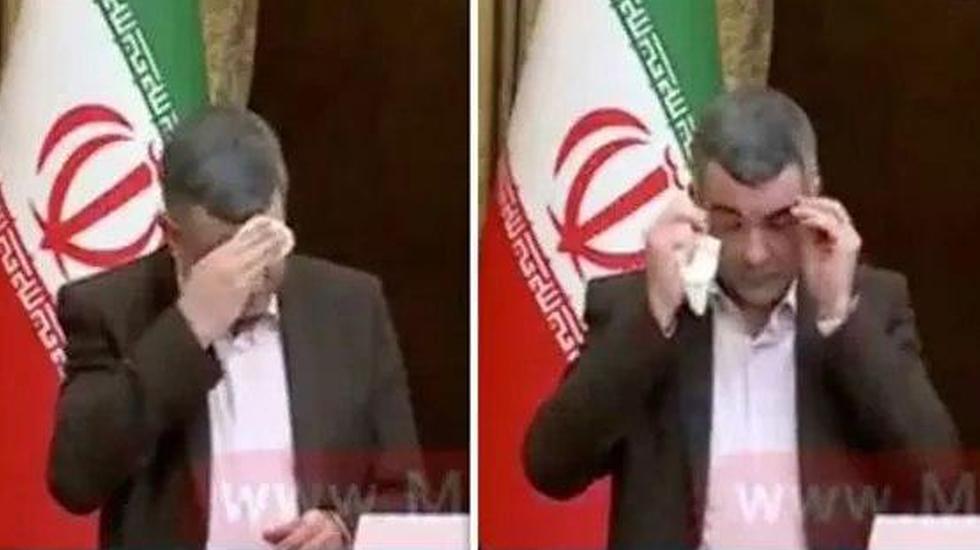 סגן שר הבריאות ב איראן נדבק בנגיף ה קורונה יום לפמני נראה מזיע ו משתעל ()