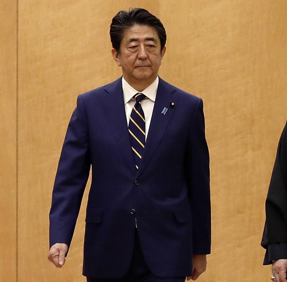 חסן רוחאני ביקור טוקיו (צילום: AP)
