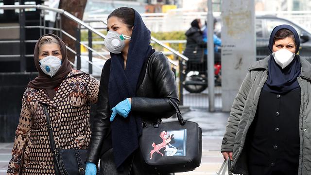 נגיף קורונה מסכות מסכה טהרן איראן (צילום: EPA)