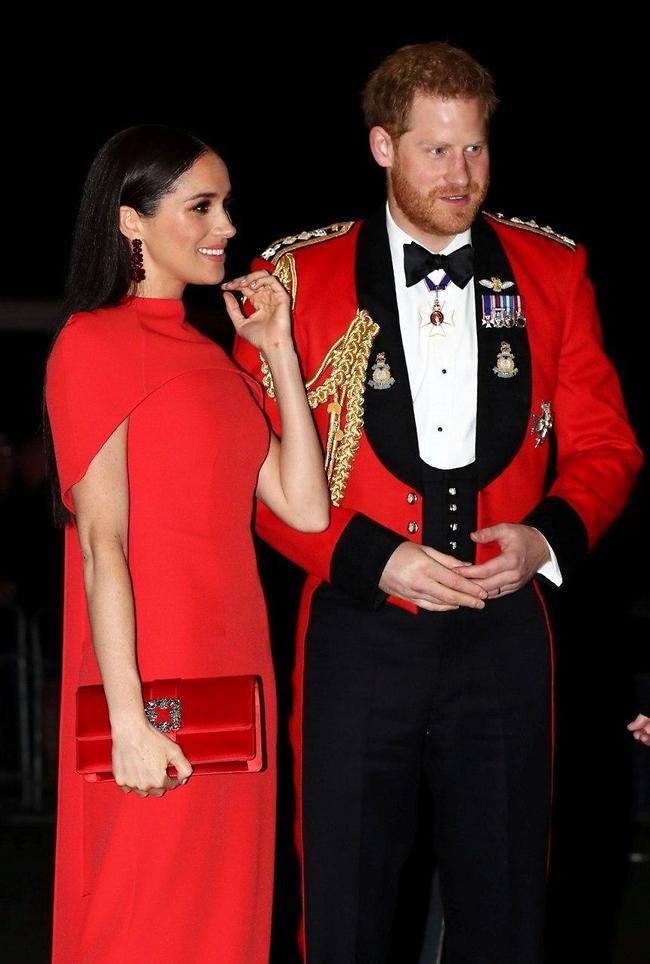 """""""אתה חושב שהרגזנו מספיק להיום?"""". הנסיך הארי ומייגן מרקל (קרדיט: Gettyimages)"""