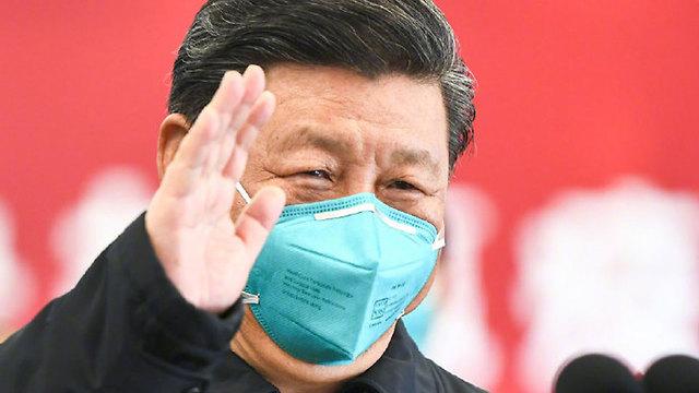 נשיא סין שי ג'ינפינג ביקור בעיר ווהאן שבה התפרץ נגיף קורונה ()