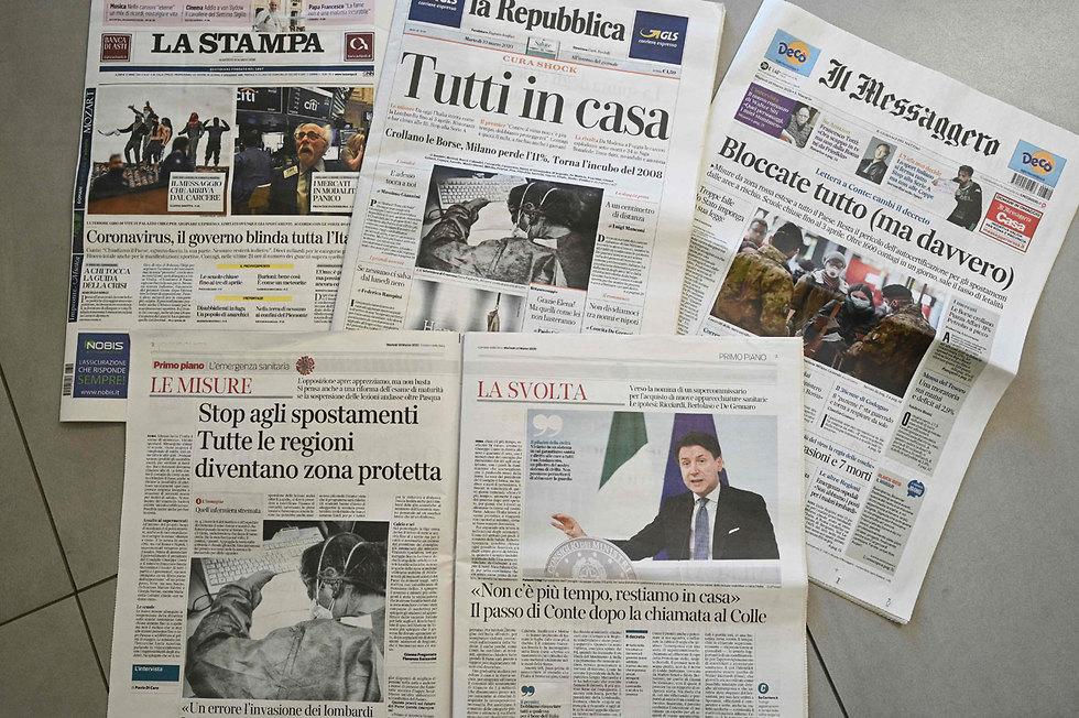 נגיף קורונה סגר על איטליה כותרות עיתונים (צילום: רויטרס)