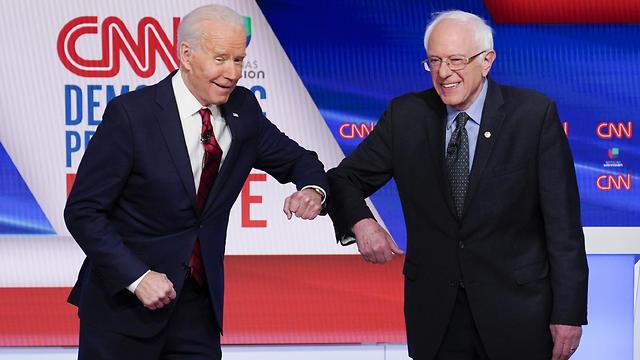 ברני סנדרס וג'ו ביידן בעימות (צילום: AP)