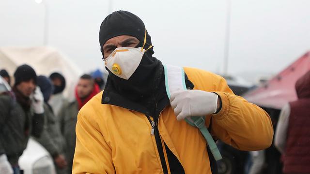 פועלים פלסטינים מחברון (צילום: AFP)