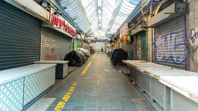 """Рынок """"Махане-Йегуда"""" в Иерусалиме прекратил работу. Фото: Шира Гершкопф, TPS (צילום: שירה הרשקופ, TPS)"""
