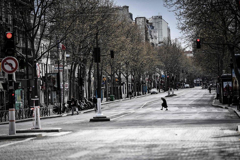 נגיף קורונה צרפת פריז רחובות ריקים (צילום: AFP)