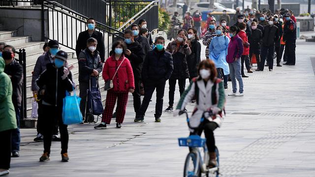 נגיף קורונה סין העיר ווהאן לקראת הסרת סגר (צילום: רויטרס)