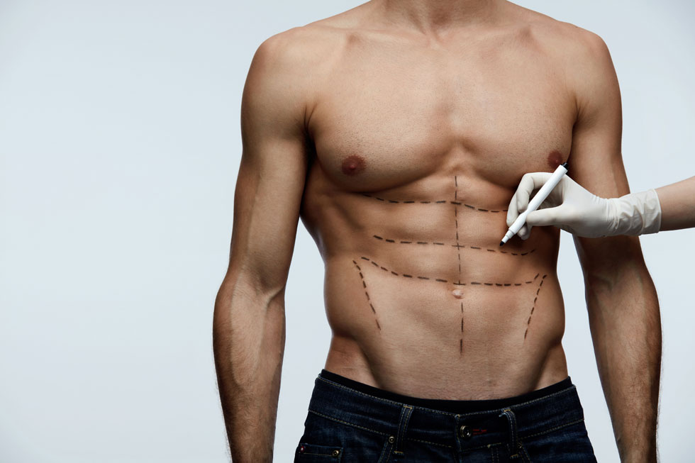 עיצוב קוביות בבטן  - מראה של בטן שעבדה חזק במכון (צילום: Shutterstock)