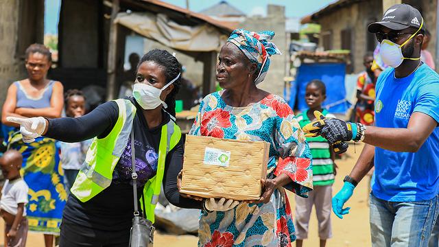 ניגריה חיטוי רחובות בדיקות קורונה (צילום: רויטרס)