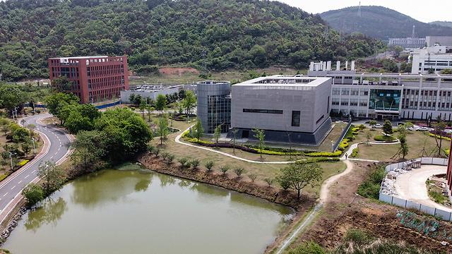 מעבדה ב מכון ווהאן לווירולוגיה ב סין טענות לא-מבוססות ש נגיף ה קורונה התפרץ שם (צילום: AFP)