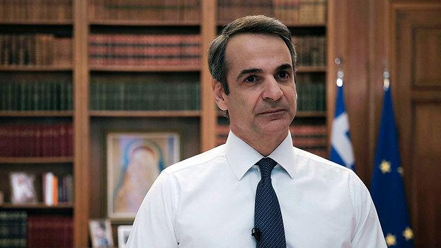 נגיף קורונה ראש ממשלת יוון קירייקוס מיצוטקיס (צילום: רויטרס)
