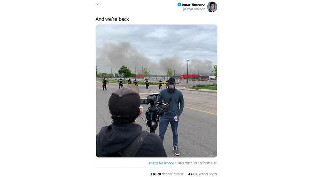 הכתב, עומאר חימנס, בעל צבע עור כהה דיווח מהפגנה במיניאפוליס ונעצר בשידור חי ()